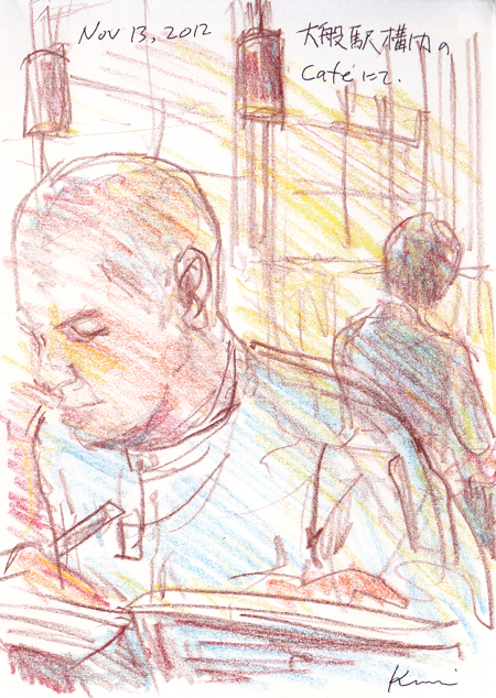 A_sketcher_in_a_cafe